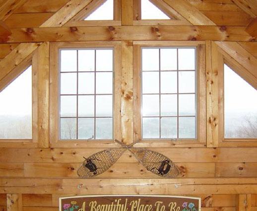 Windows in a log cabin